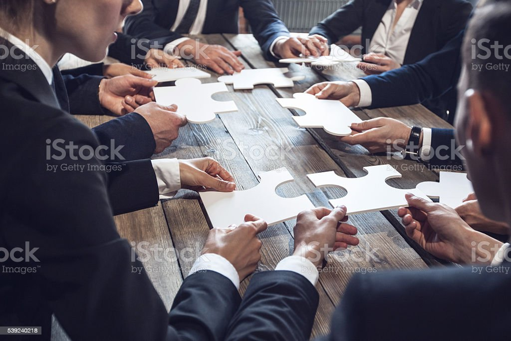 Business people and puzzle royalty-free stock photo