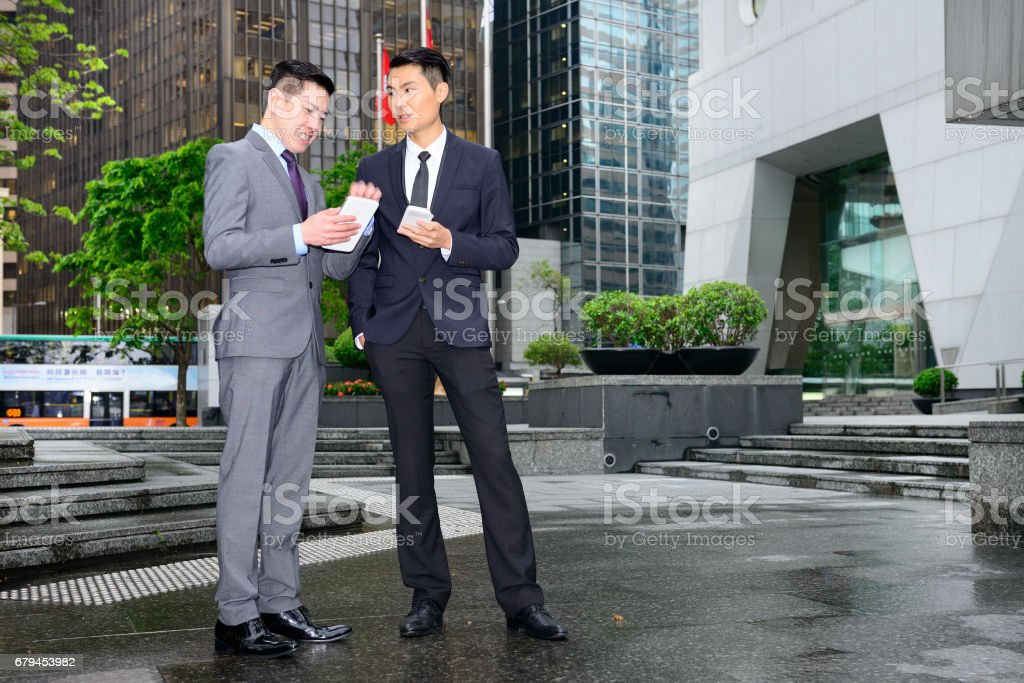 Business people and tablets and phone, discussing royalty-free stock photo