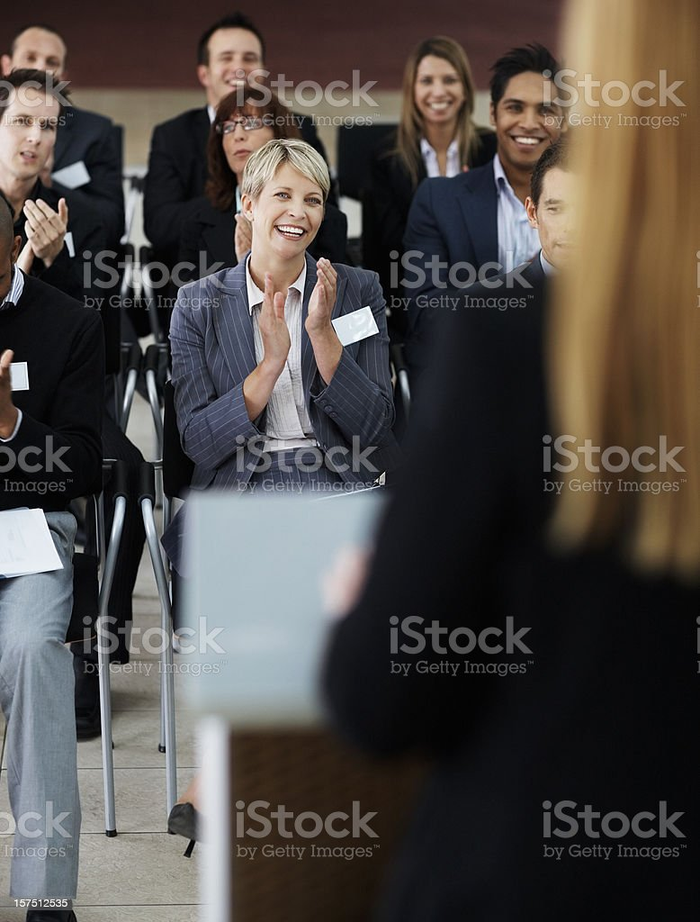 Business people applauding a lecturer at seminar royalty-free stock photo