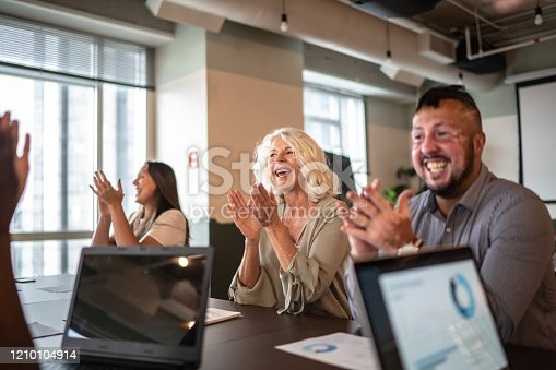 1087253494 istock photo Business people applauding and celebrating a presentation speech in a business meeting 1210104914