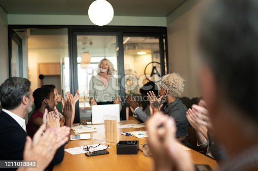858148040 istock photo Business people applauding and celebrating a presentation speech in a business meeting 1211013343