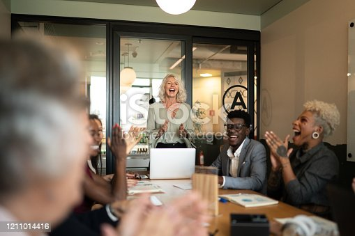 858148040 istock photo Business people applauding and celebrating a presentation speech in a business meeting 1211014416