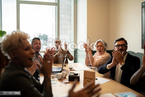 1087253494 istock photo Business people applauding and celebrating a presentation speech in a business meeting 1211017955
