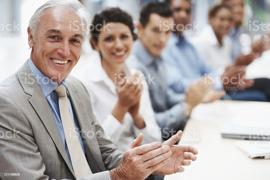Business people applauding and smiling in presentation room royalty-free stock photo