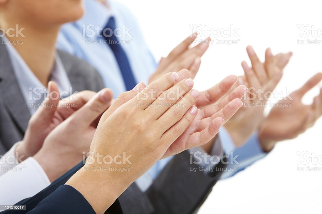 Business people applauding at a successful meeting stock photo