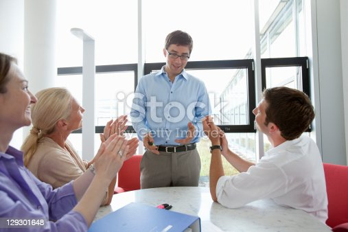 istock Business people applauding colleague 129301648