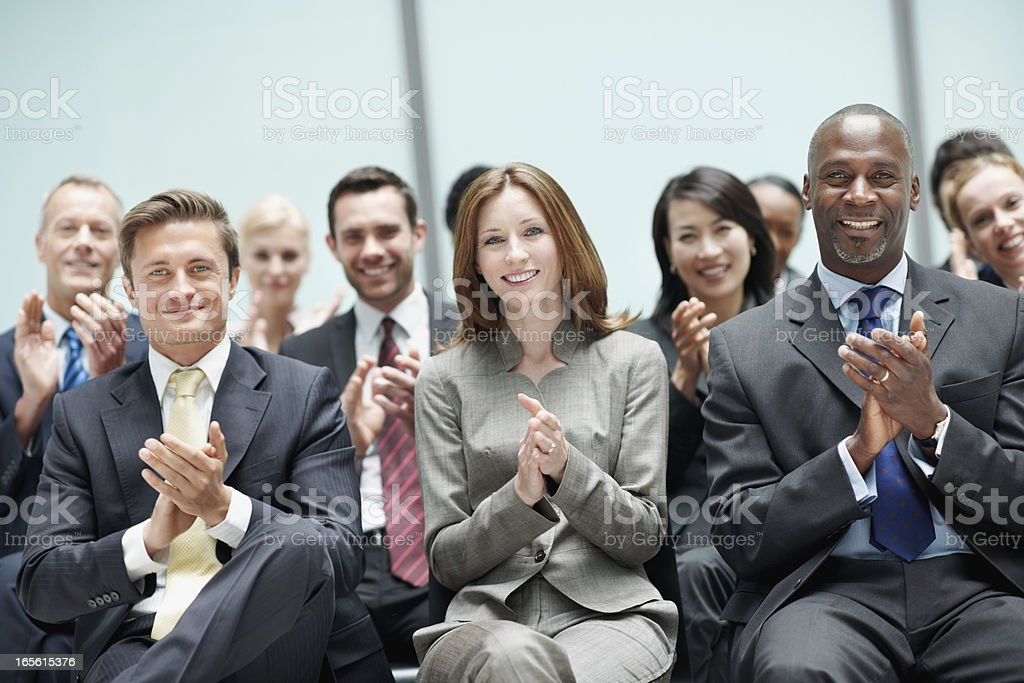 Business people applauding during presentation royalty-free stock photo