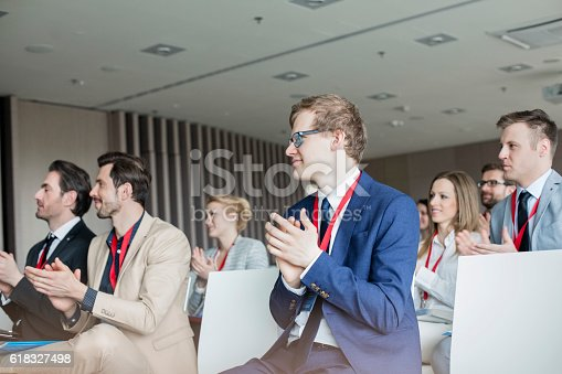istock Business people applauding during seminar 618327498