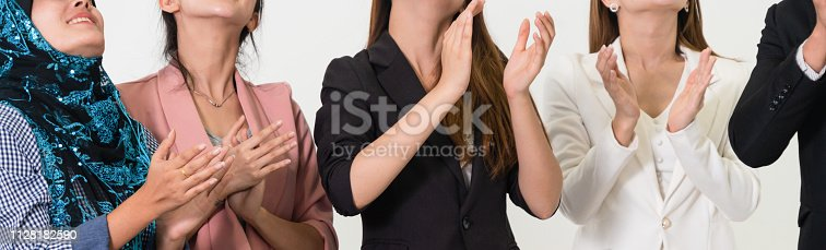 1180918029 istock photo Business people applauding in a business meeting. Conference and presentation award concept. 1128182590