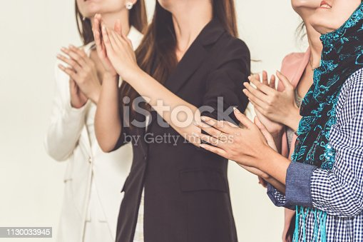 1180918029 istock photo Business people applauding in a business meeting. Conference and presentation award concept. 1130033945