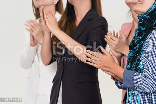 1180918029 istock photo Business people applauding in a business meeting. Conference and presentation award concept. 1134714476