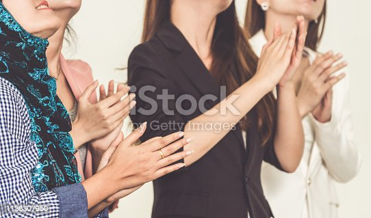 1180918029 istock photo Business people applauding in a business meeting. Conference and presentation award concept. 1138307950