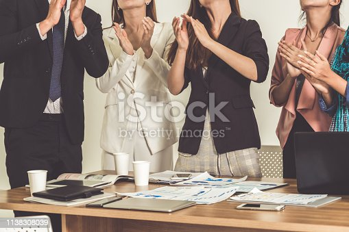 1180918029 istock photo Business people applauding in a business meeting. Conference and presentation award concept. 1138308039