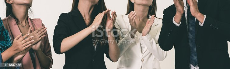 1180918029 istock photo Business people applauding in a business meeting. 1124307466