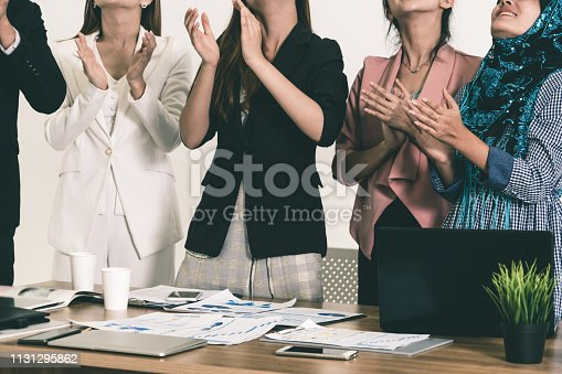1180918029 istock photo Business people applauding in a business meeting. 1131295862
