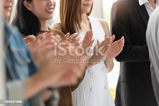 1042372612 istock photo Business people applauding in a meeting. 1069597666