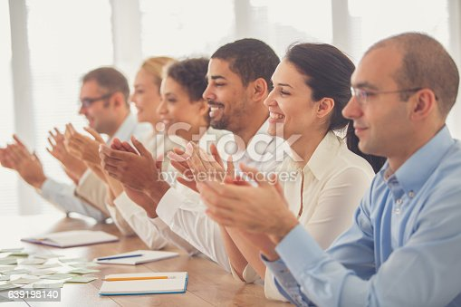 639200924 istock photo Business people applauding in meeting 639198140