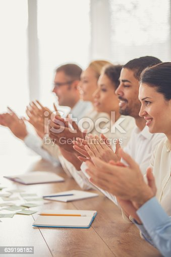 639200924 istock photo Business people applauding in meeting 639198182