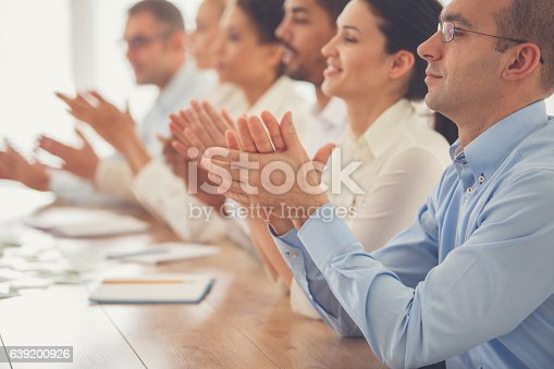 639200924 istock photo Business people applauding in meeting 639200926