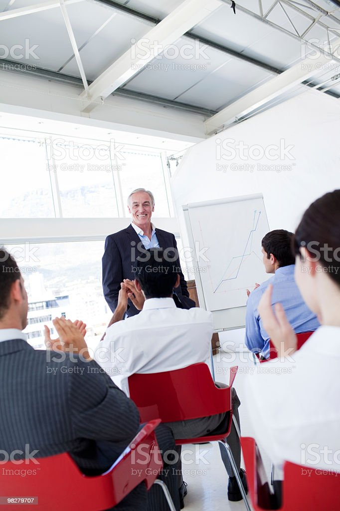 Business people applauding the speaker after a conference royalty-free stock photo