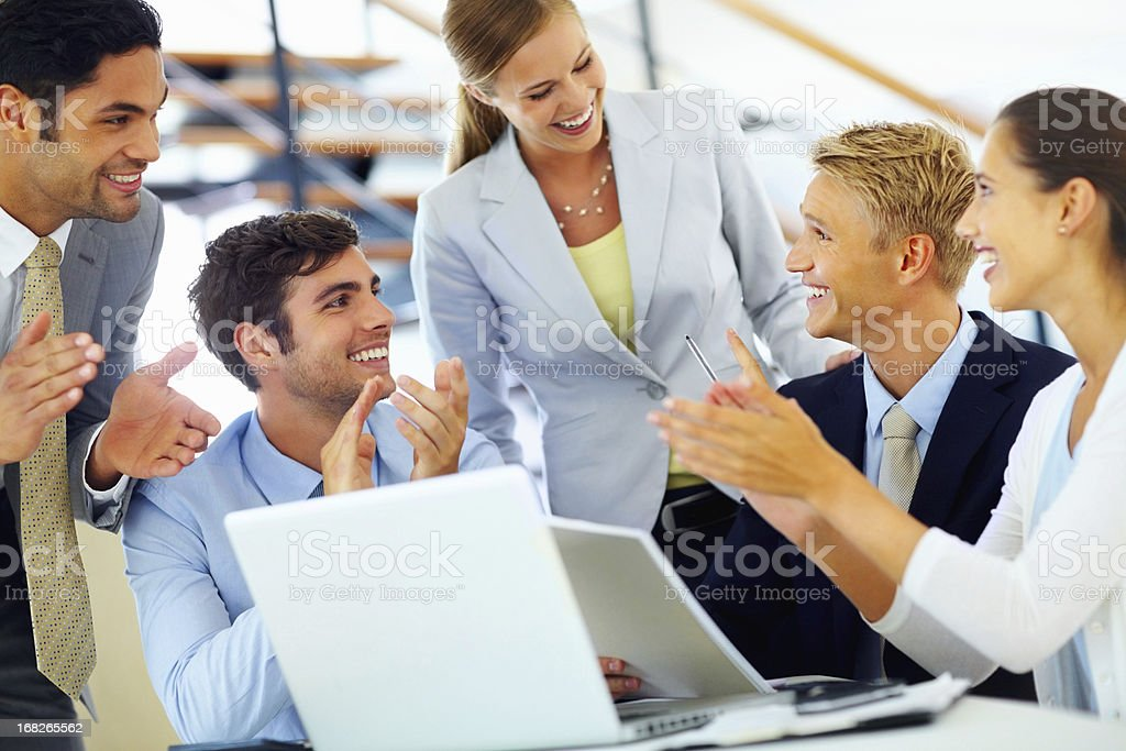 Business people applauding their colleague royalty-free stock photo