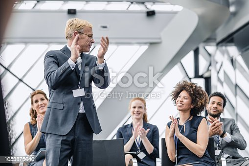 862718922 istock photo Business People Applauding To The Speaker 1053875640