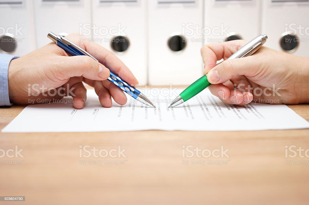 business people are examining document on table stock photo