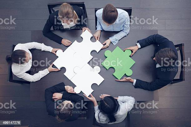 Business people assembling puzzle picture id499147276?b=1&k=6&m=499147276&s=612x612&h=xmre7jthqtlhzkhwppqvmrvcotn6g8tuecpvpzt8ebm=