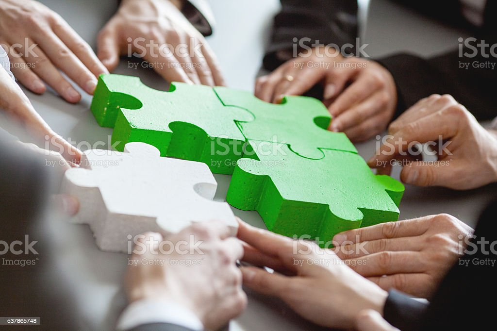 Business people assembling puzzle - Royalty-free Adult Stock Photo