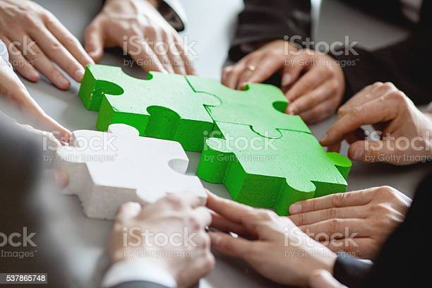 Business People Assembling Puzzle Stock Photo - Download Image Now