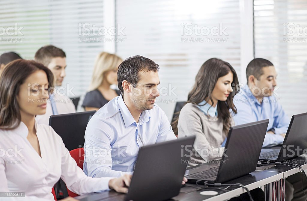Business people at a computer class. stock photo