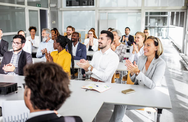 Business People at a Seminar stock photo