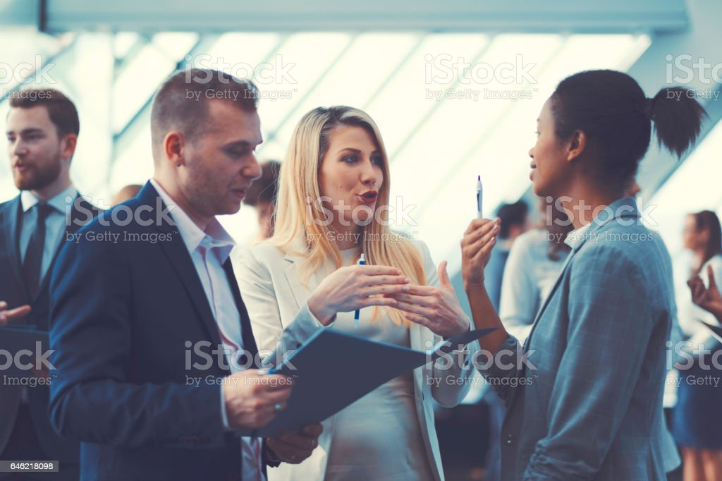 Business people at conference, coffee break stock photo
