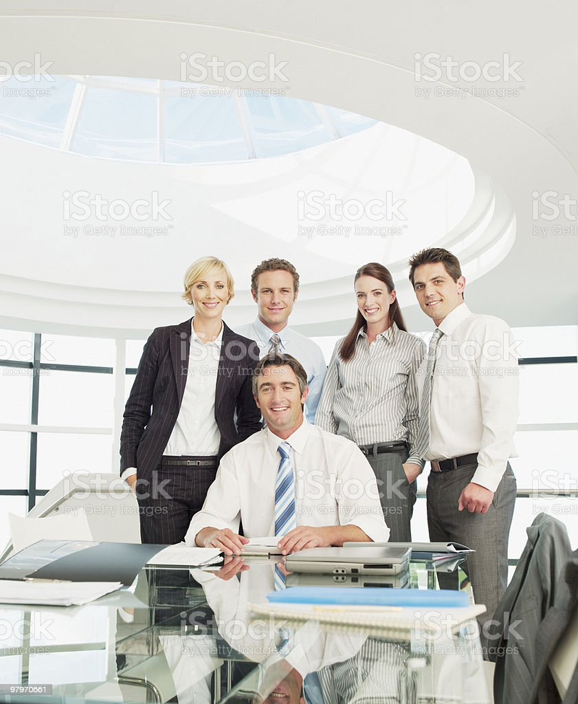 Business people at conference table in modern office royalty-free stock photo