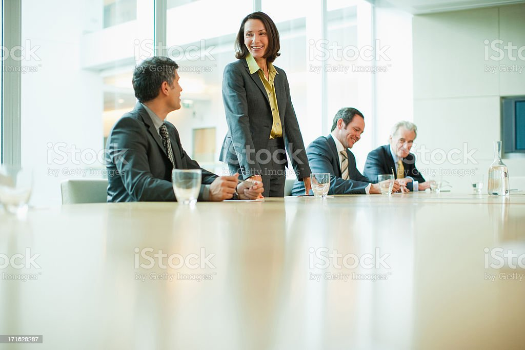 Business people at conference table in office stock photo