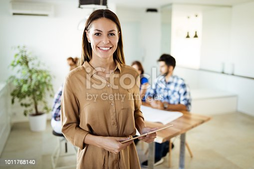 Businesswoman holding tablet at conference tablet having company meeting