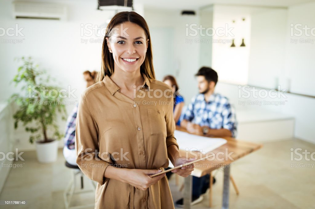 Business people at conference tablet having meeting stock photo