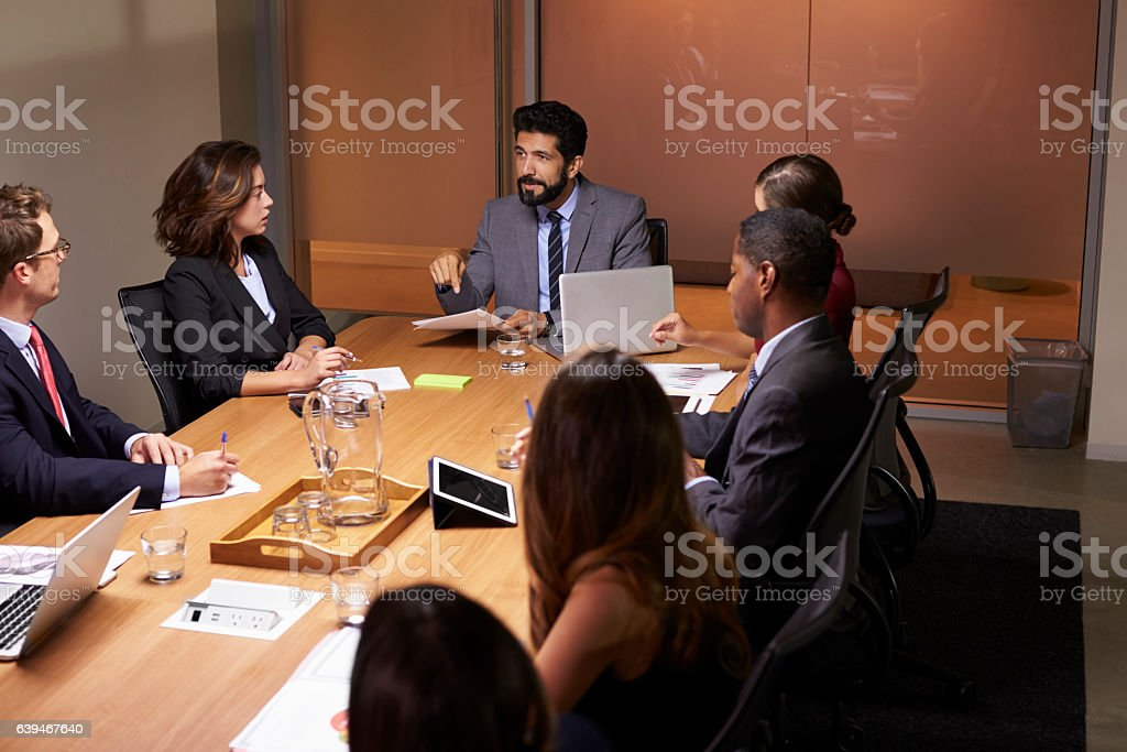 Business people at evening boardroom meeting, elevated view - Royalty-free 20-29 Years Stock Photo