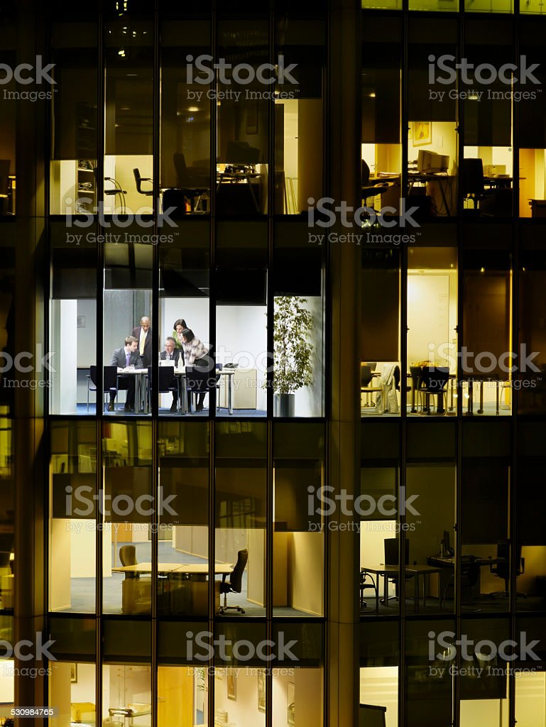 Business People At Meeting In Office Block stock photo