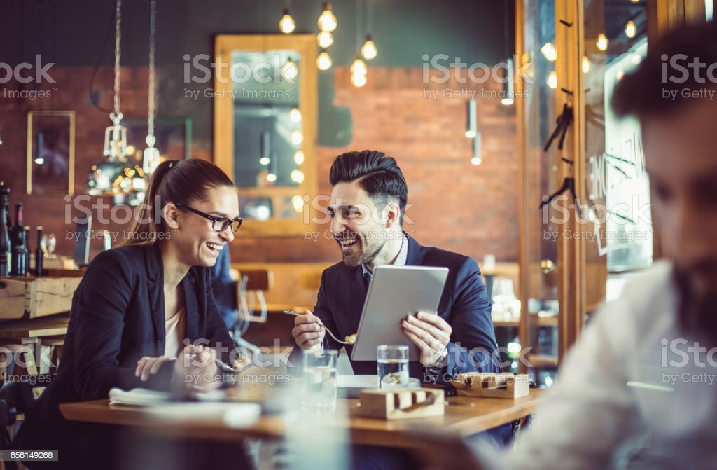 Business People at the Cafe Restaurant Discussing During Business Lunch stock photo