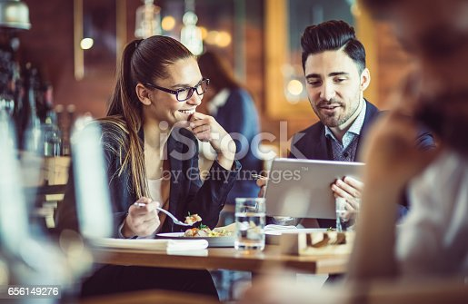 istock Business People at the Cafe Restaurant Discussing During Business Lunch 656149276