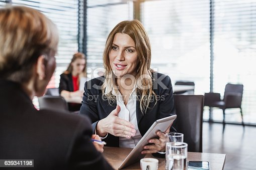 istock Business People at the Cafe Restaurant 639341198
