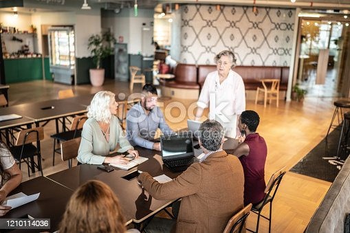 892254154 istock photo Business people attending a business meeting / seminar in board room 1210114036
