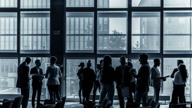 Geschäftsleute, die an einer Konferenz teilnehmen – Foto
