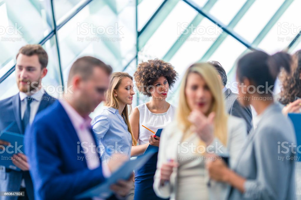 Business people attending a conference stock photo