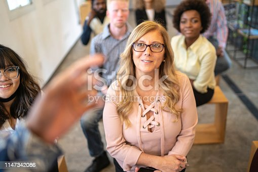 istock Business people attending a seminar in board room 1147342086