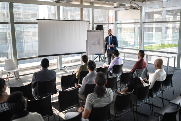 Business people attending a seminar with social distancing stock photo