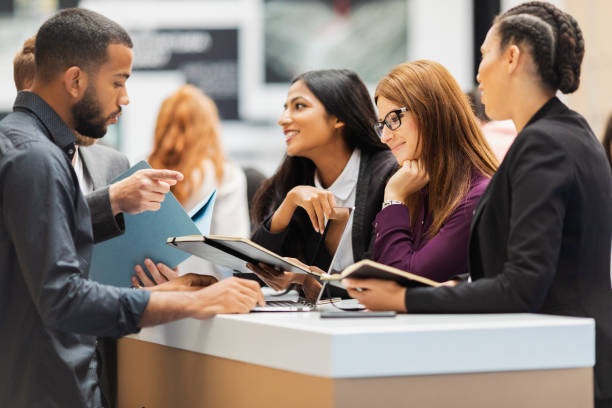 Business people attending an exhibition stock photo