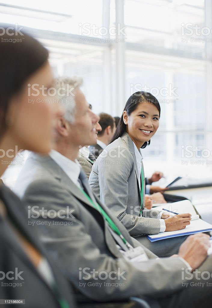 Business people attending seminar in office stock photo
