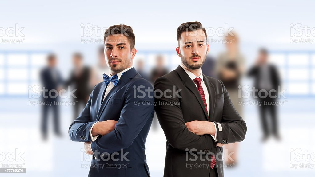Business people back to back stock photo
